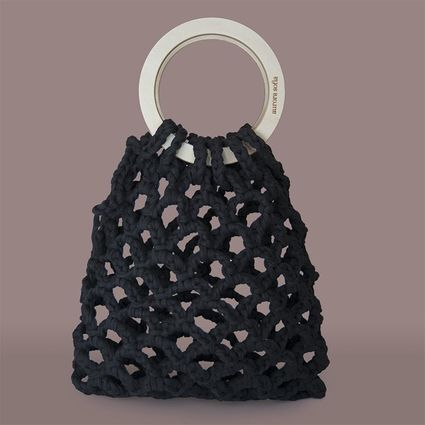 Knitted hand bag with a round wooden handle.